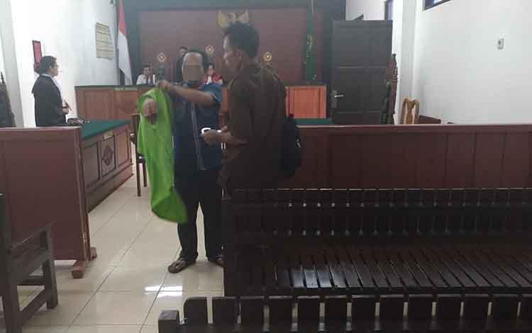 Ahmad Irfansyah, usai menjalani persidangan di Pengadilan Negeri Palangka Raya, Rabu, 19 Juni 2019.