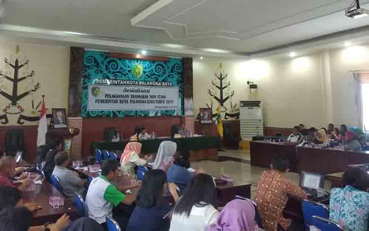 Kegiatan sosialisasi transaksi non tunai di Aula Peteng Karuhei II Balai Kota Palangka Raya, Jumat, 5 Juli 2019.