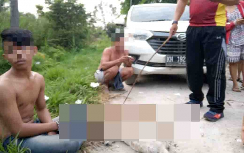 Kawanan terduga maling anjing yang ditangkap warga di Desa Hanjak Maju, Kecamatan Kahayan Hilir, Pulang Pisau, Sabtu, 10 Agustus 2019.