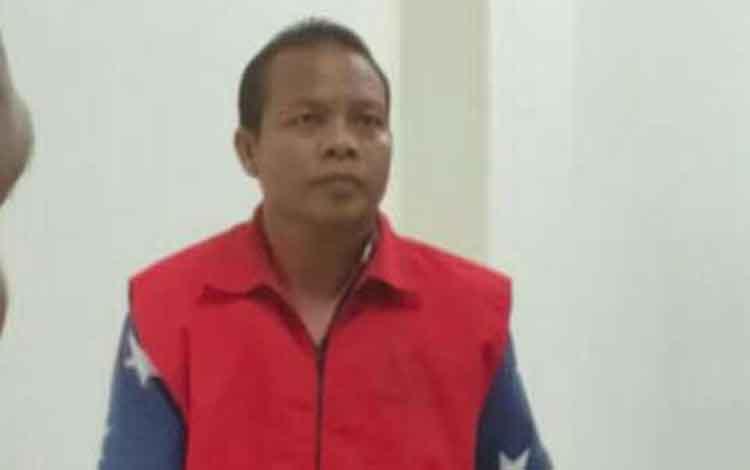 Sit, terdakwa kasus pencurian sawit milik koperasi.