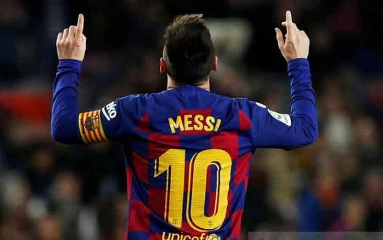 Pemain Barcelona Lionel Messi merayakan hattrick saat melawan Mallorca dalam laga lanjutan Liga Span