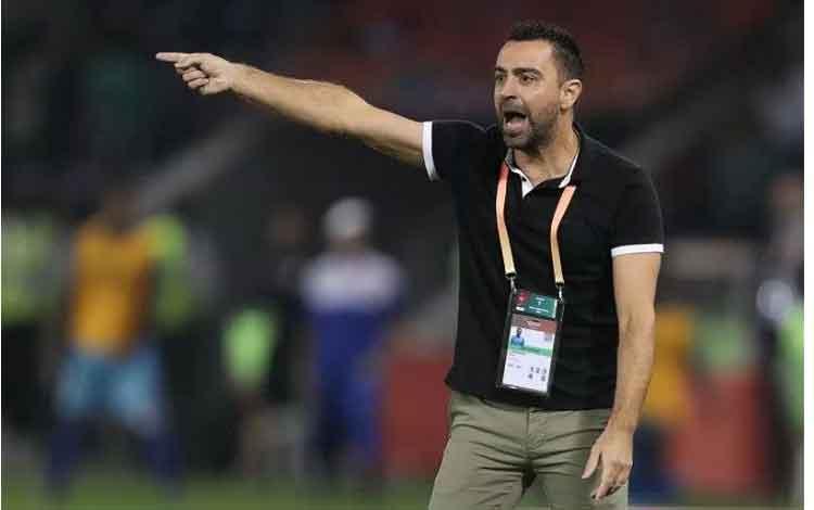 Manajer Al Sadd Xavi Hernandez memberikan arahan saat timnya meladeni Hienghene Sports dalam putaran pertama Piala Dunia Antarklub di Stadion Jassim bin Hamad, Doha, Qatar, Rabu (11/12/2019) waktu setempat. (ANTARA/AFP/Karim Jaafar)
