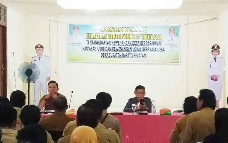 DSPMD Barito Selatan mensosialisasikan Peraturan Bupati Nomor 34 Tahun 2019 kepada kepala desa dan BPD