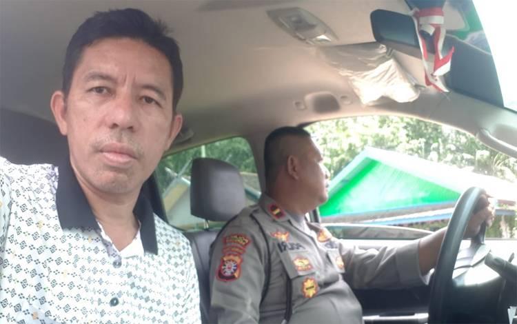 Wakil Ketua II DPRD Seruyan, M Aswin ikut bersama Kapolsek Hanau ke desa untuk menyampaikan imbauan dan kaklumat Kapolri