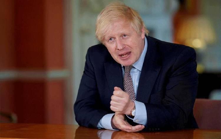 Perdana Menteri Inggris Boris Johnson berbicara selama pidato kenegaraan yang direkam dari Downing Street No 10 tentang pelonggaran lockdown selama virus corona di London, Inggris, 10 Mei 2020. [Andrew Parsons / No 10 Downing Street / Handout melalui REUTERS]