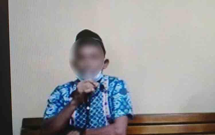 RNI, terdakwa yang merekam video tanpa busana antara dirinya dengan biduan berinisial ED.
