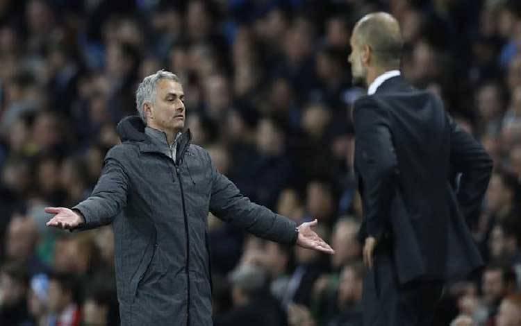 Jose Mourinho dan Pep Guardiola. Reuters