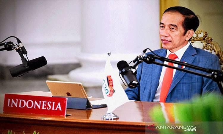 Presiden Joko Widodo saat menghadiri rangkaian Konferensi Tingkat Tinggi (KTT) G20 secara virtual melalui konferensi video dari Istana Kepresidenan Bogor, Jawa Barat, Sabtu (21/11/2020). ANTARA/HO-Biro Pers Setpres/aa. (Handout Biro Pers Sekretariat Presiden)