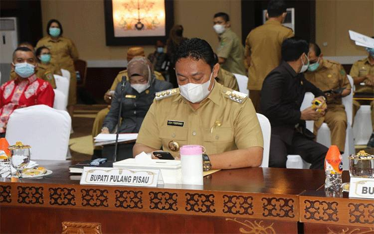 Bupati Pulpis menghadiri Rakor Program Pencegahan Korupsi pada Pemerintah Daerah se Kalteng.
