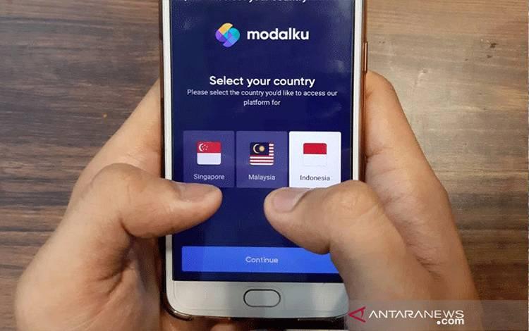 Ilustrasi - Pendaftaran aplikasi tekfin Modalku yang sudah menyediakan jasa di tiga negara Asia Tenggara yaitu Indonesia, Malaysia, dan Singapura. ANTARA/Livia Kristianti.