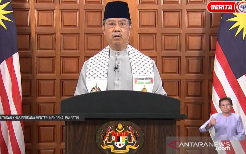 Perdana Menteri Malaysia Tan Sri Muhyiddin Yassin saat pidato khusus. (foto : ANTARA Foto/Agus Setiawan)
