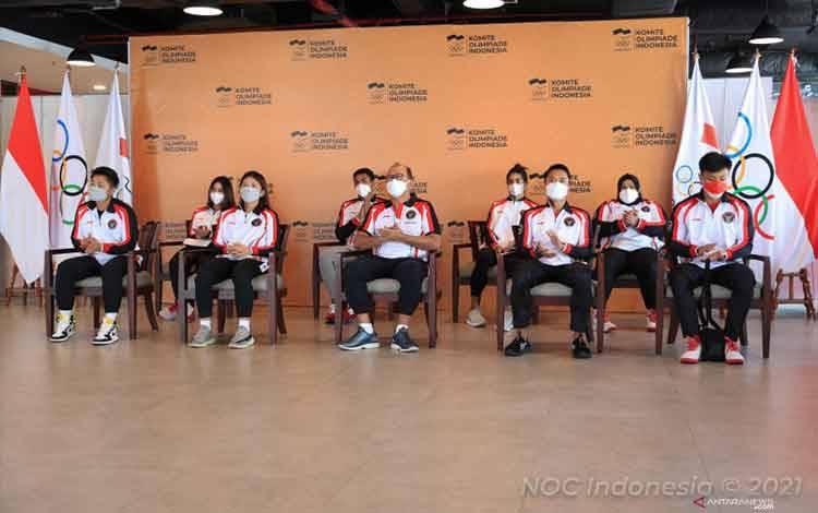 Komite Olimpiade Indonesia (KOI) memulangkan para atlet, pelatih, serta ofisial yang tergabung dalam tim Indonesia pascagelaran Olimpiade Tokyo 2020 ke federasi cabang olahraga masing-masing di Kantor KOI, Senayan, Jakarta, Kamis (12/8/2021). (ANTARA/HO/KOI-Naif Al'as)