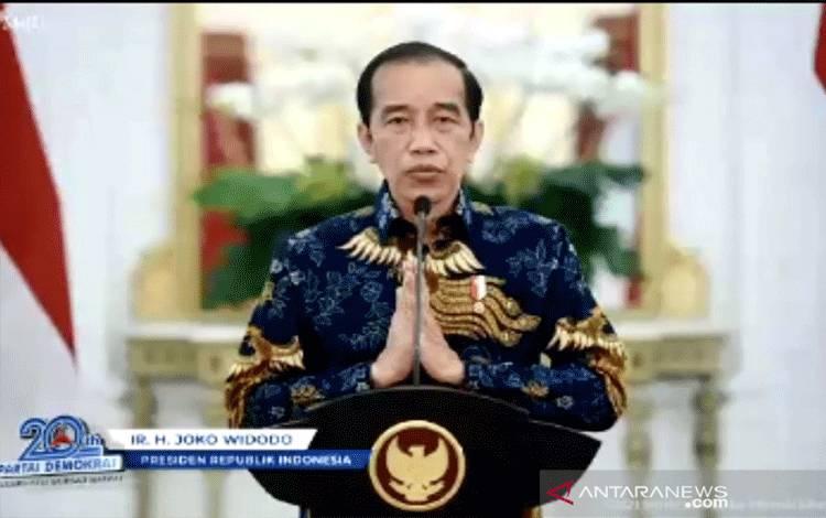 Tangkapan layar Presiden Republik Indonesia Joko Widodo menyampaikan ucapan selamat kepada Partai Demokrat yang memperingati HUT ke-20 di JCC, Jakarta, Kamis (9/9/2021), sebagaimana ditayangkan secara virtual lewat aplikasi Zoom. ANTARA/Genta Tenri Mawangi