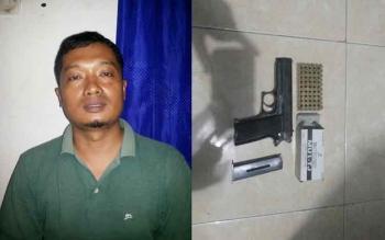 Jarot Hartana (39) Warga Jalan Keruing, Kelurahan Selat Dalam, Kecamatan Selat, Kapuas, diamankan polisi karena memiliki senjata api rakitan Jenis FN caliber 9 mm dan 50 butir amunisi. BORNEONEWS/DJEMMY NAPOLEON