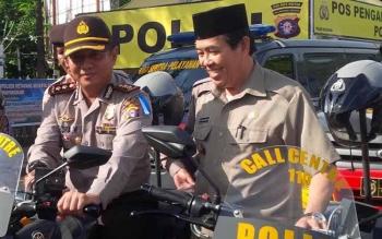 Ilustrasi: Wakil Bupati Kotim, M Taufiq Mukri (kanan) bersama Kapolres Kotim, AKBP Hendra Wirawan. BORNEONEWS/DOK