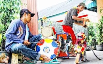 Topeng monyet. BORNEONEWS/WAHYU KRIDA