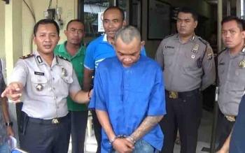 Herman Naga, tersangka penusukan sudah ditangkap aparat kepolisian.
