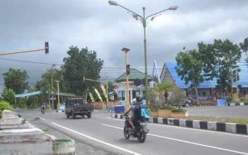 Suasana Jalan Pangeran Sukarma jalur lampu merah simpang empat Sukamara.