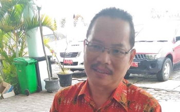 Kepala Dinas Pengendalian Penduduk dan Keluarga Berencana Kabupaten Gunung Mas (Gumas) Isaskar