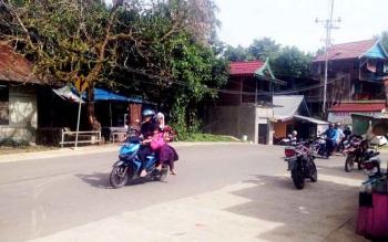 Jalan Ahmda Yani (depan Kantor PWI Mura) Kota Puruk Cahu