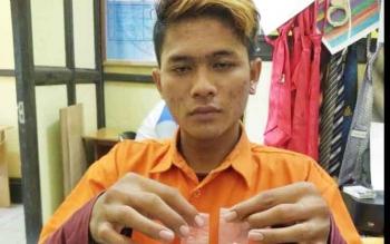 Fajrin, warga Kuala Kuayan, Kabupaten Kotim yang ditangkap Polres Seruyan karena memiliki dua paket sabu.