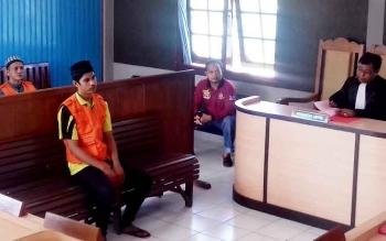 Taher terdakwa kasus pembunuhan saat menjalani sidang, Rabu (22/3/2017)