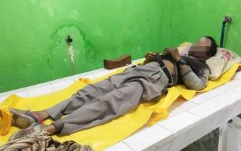 Jasad Ahmad Justnaidi alias Jenei (48) di kamar mayat Rumah Sakit Sultan IManuddin Pangkalan Bun, Rabu (29/3/2017).