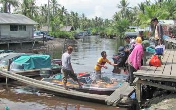 Pelabuhan sungai bantu Kecamatan Pantai Lunci saat masih aktif beroperasi.