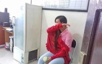 Nelly Dewi Putri, tersangka kasus zenith.
