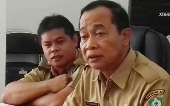 Sekda Kotim, Putu Sudarsana dan Plt Kepala BKD Kotim Alang Arianto.