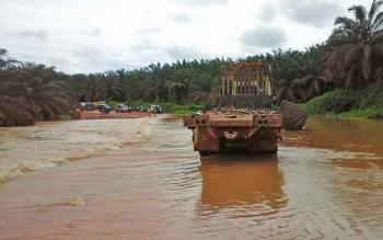 Ruas jalan Korintiga menuju Pangkut yang sempat terendam banjir