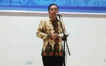 Sekda Barito Utara, Jainal Abidin saat membacakan sambutan bupati Barito Utara dalam pertemuan kunjungan kerja pemerintah Kabupaten Tapin, Kalimantan Selatan.