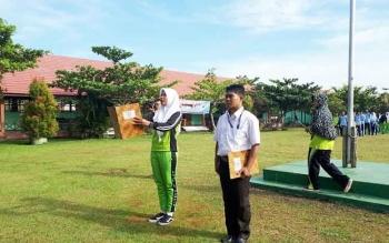 Pengucapan janji wasit dan atlet pada Pembukaan O2SN di SMAN 4, Kotim, Kamis (27/4/2017)