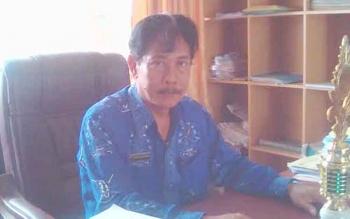 Kepala sekolah SMAN 1 Tamiang Layang, Rogan Gunawan.