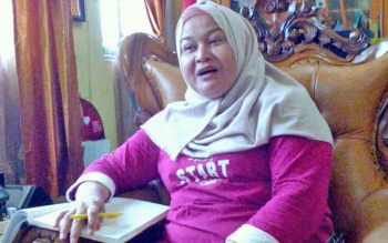 Wakasek Humas SMAN 4 Palangka Raya, Dewi.