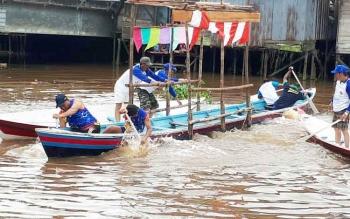 Lomba besei kambe, di Sungai Mentaya, Sampit, Minggu (21/5/2017).