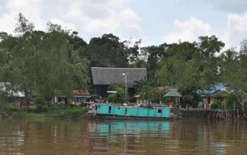 Desa Bontoi yang terkenal dengan wisata rumah betang