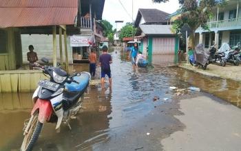 Kondisi Kampung Beriwit yang berada di Jalan Merdeka Kota Puruk Cahu saat banjir, Rabu (31/5/2017).