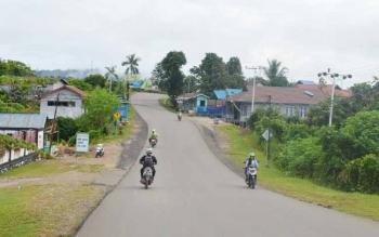 Situasi jalan Kota Puruk Cahu, Kabupaten Murung Raya. Di Murung Raya, terdapat 20 kasus gigitan anjing pada 2017.