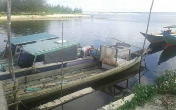 Seorang nelayan Desa Sungai Bakau Kecamatan Seruyan Hilir Timur saat tidak melaut.