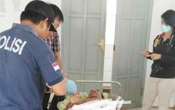 Jasad Buyadi saat di kamar mayat RSUD Kuala Kurun, Kamis (8/6/2017)
