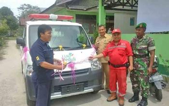 TSAK Bukit Tunggal saat menerima bantuan mobil bak terbuka dari PLN