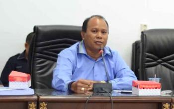 Anggota DPRD Barito Utara, Purman Jaya pada saat memimpin rapat