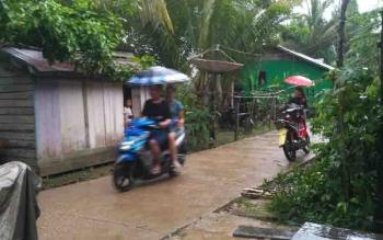 Hujan yang mengguyur Kota Puruk Cahu.