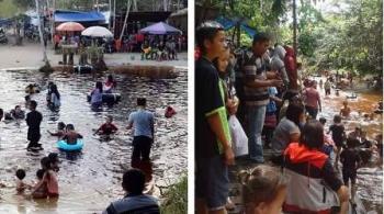 Warga Kota Buntok, Kabupaten Barito Selatan, berwisata di objek wisata alam Rawen dan Banyu Habang, Desa Sanggu, Kecamatan Dusun Selatan, Senin (26/6/2017).
