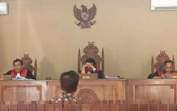 Sidang pembacaan putusan dalam kasus korupsi yang menjerat Henry Singarasa, Rektor Universitas Palangka Raya, 2005-2013