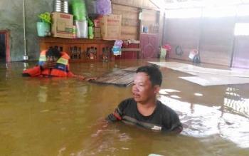Banjir di Desa Sare Rangan, Kecamatan Tewah, Kabupaten Gunung Mas, beberapa hari lalu.