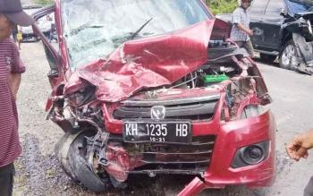 Inilah Mobil Karimun Merah yang Ditumpangi Mido (26).