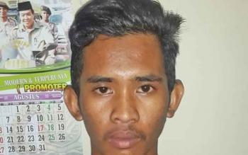 Andre Jangkung Nugroho, tersangka tindak asusila anak di bawah umur.