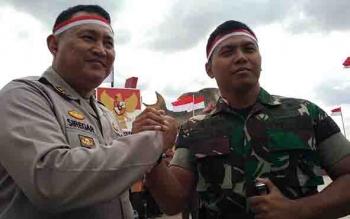 Kapolres Kotim AKBP Muchtar Supiandi Siregar kompak bersama Dandim 1015 Sampit, Letkol Inf I Gede Putra Yasa.